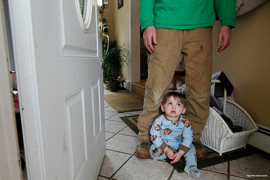With one-year-old son James at his feet, neighbor James Daley talks about Danville police chief Wade H. Parson in Danville, N.H., where a 15-year-old boy was found shot to death at Parson's home.  Tuesday, March 12, 2013.  (Cheryl Senter for the Boston Globe)