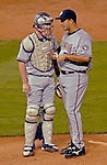 8 September 2006: Brian Schneider (left), catcher for the Washington Nationals, has a mound conference with pitcher Tony Armas Jr. (right) in a game against the Colorado Rockies. The Rockies defeated the Nationals 11-8 at Coors Field in Denver, Colorado...Mandatory Photo Credit: Ed Wolfstein.