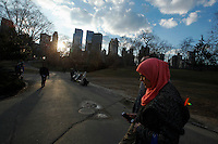 A woman walks in Central Park during the fist day of Spring in New York City. March 20, 2014. Photo by Eduardo Munoz/VIEW
