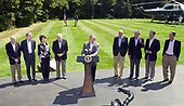 Camp David, MD - August 18, 2006 -- United States President George W. Bush holds a press availability after meeting with his economic advisors at Camp David, Maryland, Friday, August 18, 2006.  From left to right: Ed Lazear, Chairman of Council of Economic Advisors; Rob Portman, Director of Office of Management and Budget (OMB; Elaine Chao, Secretary of Labor; Vice President Dick Cheney; President Bush; Henry Paulson, Secretary of the Treasury; Carlos Gutierrez, Secretary of Commerce; Mike Leavitt, Secretary of Health and Human Services (HHS) and Al Hubbard, Economic Policy Advisor.<br /> Credit: Ron Sachs / Pool via CNP