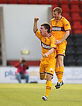 Ross Forbes celebrates with Mark Reynolds after his long range shot goes in to give Motherwell the lead