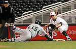 Michigan State's Anthony Cheky (15) dives safely back to first as Maryland first baseman Kevin Biondic gets the late throw during the seventh inning of a Big 10 tournament baseball game in Minneapolis, Wednesday, May 20, 2015. Maryland defeated Michigan State 2-1. (Photo/Ann Heisenfelt)