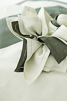 Black and white linen napkins wrapped together for maximum effect