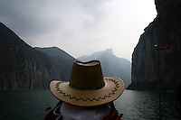 CHINA. Chongqing Province.  A tourist looks out onto the 3 Gorges. The flooding of the three Gorges, by damming the Yangtze near the town of YiChang, has remained a controversial subject due to the negative environmental consequences and the displacement of millions of people in the flood plain. The Yangtze River however is reported to be at its lowest level in 150 years as a result of a country-wide drought. It is China's longest river and the third longest in the world. Originating in Tibet, the river flows for 3,964 miles (6,380km) through central China into the East China Sea at Shanghai.  2008.