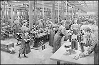 BNPS.co.uk (01202 558833)<br /> Pic: FortuninoMataniaR.I./Christies/BNPS<br /> <br /> ***Use Full Byline***<br /> <br /> Women working in a munitions factory during 1915. <br /> <br /> Original art work chronicling major historical moments in British history that was for the world's first illustrated magazine is being sold at auction.<br /> <br /> The colourful drawings were for the front pages of The Illustrated London News and depict key events in the 20th century including the Royal wedding of Queen Elizabeth II and Phillip Mountbatten.<br /> <br /> Other moments in history illustrated include the coverage of both world wars and the Festival of Britain.<br /> <br /> The work is being sold by auctioneers Christie's in October