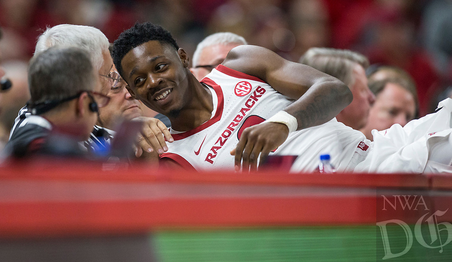 NWA Democrat-Gazette/BEN GOFF @NWABENGOFF<br /> Adrio Bailey of Arkansas gets up from the scorer's table after diving for a ball headed out of bounds in the first half vs Western Kentucky Saturday, Dec. 8, 2018, at Bud Walton Arena in Fayetteville.