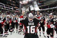 Binghamton Senators' Cody Bass lifts the Calder Cup after game six of the AHL Calder Cup Finals, Tuesday, June 7, 2011, in Houston. Binghamton won 3-2 to win the championship. (Darren Abate/pressphotointl.com/AHL)