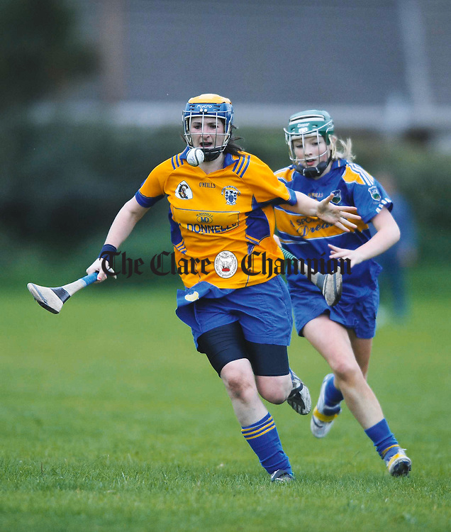 Clare's Sinead Tuohy in action against Tipperary's Clare Kennedy during the U-16 Munster Camogie final at Monaleen, Limerick. Photograph by John Kelly.