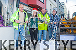 Catherine Curran from the Round Tower comes out to give the boys a hand at putting up the lights in Cahersiveen pictured l-r; Jim O'Sullivan, Catherine Curran, Denis O'Connor & John Kennedy.