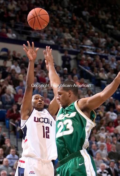 HARTFORD, CT. 02 January 2007-010207SV01--#12 A.J. Price of UConn puts up a shot over #23 Jesus Verdejo of South Florida during basketball action at the Civic Center in Hartford Tuesday. <br /> Steven Valenti / Republican-American