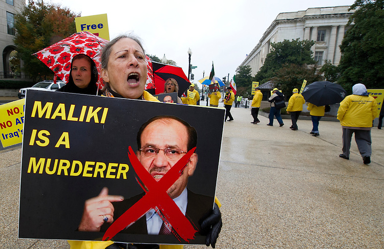 UNITED STATES - Oct 30: Protesters carry signs and chant outside of the Dirksen Senate Office Building protesting the Iraqi leader Maliki who is visiting Capitol Hill today to talk with Congressional Leadership on October 30, 2013. (Photo By Douglas Graham/CQ Roll Call)