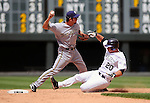 June 08, 2008 - Denver, CO.   Milwaukee's shortstop, J.J. Hardy turns a double play during action between the Milwaukee Brewers and the Colorado Rockies...Brewers defeat the Rockies 3-2...Larry Clouse/Cal Sport Media