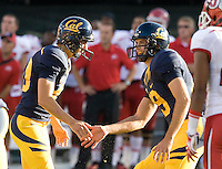 Bryan Anger of California shakes hands with Giorgio Travecchio after Travecchio scored a field goal during the game against Utah at AT&T Park in San Francisco, California on October 22, 2011.   California defeated Utah, 34-10.