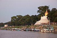 Myanmar, Burma.  Buddhist Stupa and Local Boats on Ayeyarwady (Irrawaddy) River Bank.