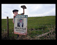Kevin healy-Rae, son of Michael and grandson of jackie. putting up posters<br /> Picture by Don MacMonagle
