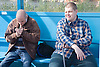Two friends sitting in bus shelter whilst on a day trip to Skegness organised by Nottingham Disabled Friendship Club,