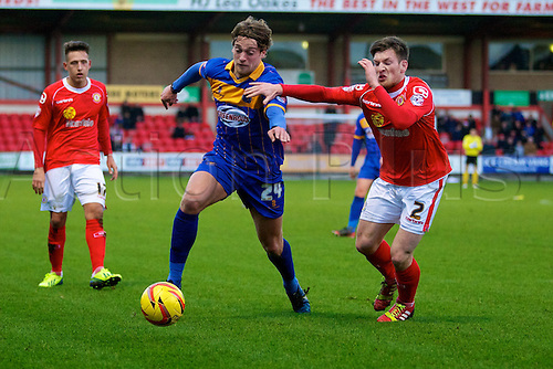 21.12.2013 Crewe, England. Shrewsbury Town forward Tom Eaves and Crewe Alexandra defender Matt Tootle during the League One game between Crewe Alexandra and Shrewsbury Town from the Alexandra Stadium.