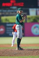 Greensboro Grasshoppers relief pitcher Braeden Ogle (14) looks to his catcher for the sign against the Piedmont Boll Weevils at Kannapolis Intimidators Stadium on June 16, 2019 in Kannapolis, North Carolina. The Grasshoppers defeated the Boll Weevils 5-2. (Brian Westerholt/Four Seam Images)