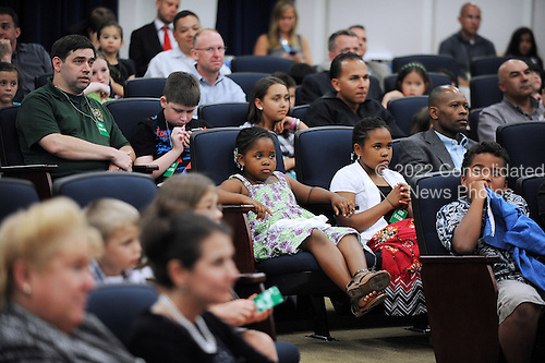 "United States President Barack Obama hosts Military Fathers and Children for a screening of ""Cars 2"" in Advance of Father's Day in the South Court Auditorium, June 15, 2011, at the White House in Washington D.C..Credit: Olivier Douliery / Pool via CNP"