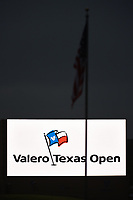 A Valero Texas Open video board lights up the green near 18 in front of the American flag during day 1 of the Valero Texas Open, at the TPC San Antonio Oaks Course, San Antonio, Texas, USA. 4/4/2019.<br /> Picture: Golffile | Ken Murray<br /> <br /> <br /> All photo usage must carry mandatory copyright credit (© Golffile | Ken Murray)