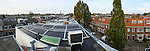 Nederland, Utrecht, 01-10-2014 Installatie van zonnepanelen  FOTO: GerardTil