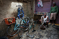 A Cuban bike mechanic trues a wheel in the bicycle repair shop in Havana, Cuba, 10 February 2011.