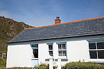 Photovoltaic roof tiles on building, Kynance Cove, Lizard Peninsula, Cornwall, England, UK