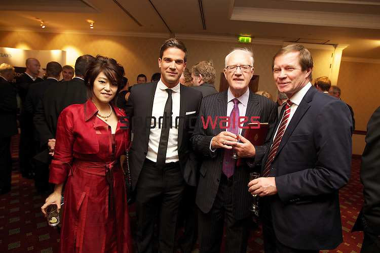 ISPS Handa Wales Open 2012.Gala Dinner.Midori Miyazaki from ISPS with Gethin Jones, Lord Carey and European Tour Chief Executive George O'Grady..29.05.12.©Steve Pope