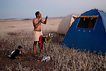 KUNENE, NAMIBIA - APRIL 26: M.A Sanjayan, age 41, a lead scientist for the Nature Conservancy shaves in a camp on April 26, 2008 in Kunene, Namibia. He participated in a 2-week survey with a walking safari with camels and a crew through 155 miles of proposed parkland through the savanna at Etosha National park, through rocky badlands, across the world's oldest desert, the Namib and the blinding dunes and fogy cliffs at Skeleton Coast on the Atlantic Ocean. One of the missions was to track the black Rhinoceros who is now brought back from certain extinction, and more than one hundred fifty of them roam free in this remote area. (Photo by Per-Anders Pettersson)....