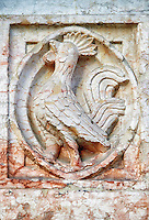 Medieval relief sculptures of mythical bird on the exterior of the Romanesque Baptistery of Parma, circa 1196, (Battistero di Parma), Italy