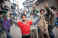 Srinagar, India-August 8, 2010: Kashmiri protesters pose for a photograph during a stand-off with Indian police and military in downtown Srinagar