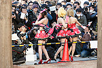 Photographers take pictures of cosplayers during the Comic Market 91 (Comiket) event in Tokyo Big Sight on December 31, 2016, Tokyo, Japan. Manga and anime fans arrived in the early morning hours on the opening day of the 3-day long event. Held twice a year in August and December, the Comiket has been promoting manga, anime, game and cosplay culture since its establishment in 1975. (Photo by Rodrigo Reyes Marin/AFLO)
