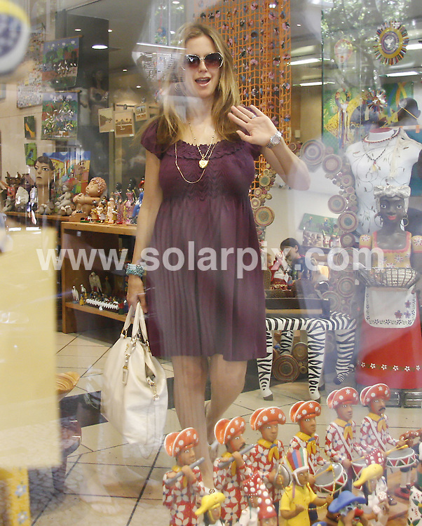 **ALL ROUND PICTURES FROM SOLARPIX.COM**.**SYNDICATION RIGHTS FOR UK AND SPAIN ONLY**.John Travolta's wife American actress Kelly Preston, who is pregnant of twins, and their daughter Ella, were pictured shopping for jewels at a store in Ipanema, Rio de Janeiro in Brazil..This pic:    Kelly Preston.JOB REF:     11487     PRT        DATE:   16.06.10.**MUST CREDIT SOLARPIX.COM OR DOUBLE FEE WILL BE CHARGED**.**MUST NOTIFY SOLARPIX OF ONLINE USAGE**.**CALL US ON: +34 952 811 768 or LOW RATE FROM UK 0844 617 7637**