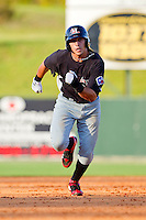 Jacob Skole #7 of the Hickory Crawdads hustles towards third base against the Kannapolis Intimidators at Fieldcrest Cannon Stadium on April 17, 2011 in Kannapolis, North Carolina.   Photo by Brian Westerholt / Four Seam Images