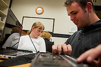 Laura Boelens, 15, (in white) and Adam Roberge, 20, (right) use BrailleNote Apex Notetakers in computer class with Kate Crohan, Teacher of the Visually Impaired in the Secondary Program at Perkins School for the Blind in Watertown, Massachusetts, USA, on Tues., Oct. 15, 2013. The Apex has wifi capabilities and works as a word processor, web browser, calculator, and email device. Roberge, here, also uses a computer that reads the contents of the screen to him. Boelens is using the Apex to read news articles that Crohan has picked out for her. The Apex device is controlled through the braille keyboard buttons at the top. Emails and other documents are displayed in braille across the bottom row of the device. Crohan's class helps familiarize students with these devices and also general computer literacy.