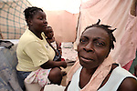 This woman is among hundreds of earthquake survivors huddled in tents and makeshift shelters in a soccer stadium in the Santa Teresa area of Petionville, Haiti. Hundreds of thousands of Haitians were left homeless by the January 12 quake.