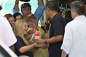 United States President Barack Obama greets well wishers outside of Island Snow on January 3, 2013 in Kailua, Hawaii. .Credit: Kent Nishimura / Pool via CNP
