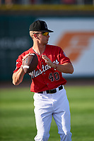 Billings Mustangs TJ Hopkins (40) throws a football before a Pioneer League game against the Grand Junction Rockies at Dehler Park on August 15, 2019 in Billings, Montana. Billings defeated Grand Junction 11-2. (Zachary Lucy/Four Seam Images)