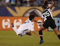 Briget Prinz of the Carolina Courage goes flying over the leg of Jacklyn Raveia of the NY Power. The Courage defeated the Power 2-1 on Wednesday August 7th at Mitchel Athletic Complex, Uniondale, NY.