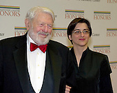 Theodore Bikel and a guest arrives for the formal Artist's Dinner honoring the recipients of the 2012 Kennedy Center Honors hosted by United States Secretary of State Hillary Rodham Clinton at the U.S. Department of State in Washington, D.C. on Saturday, December 1, 2012. The 2012 honorees are Buddy Guy, actor Dustin Hoffman, late-night host David Letterman, dancer Natalia Makarova, and the British rock band Led Zeppelin (Robert Plant, Jimmy Page, and John Paul Jones)..Credit: Ron Sachs / CNP