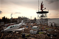 Cars and planes among extensive debris at Sendai airport. On 11 March 2011 a magnitude 9 earthquake struck 130 km off the coast of Northern Japan causing a massive Tsunami that swept across the coast of Northern Honshu. The earthquake and tsunami caused extensive damage and loss of life.