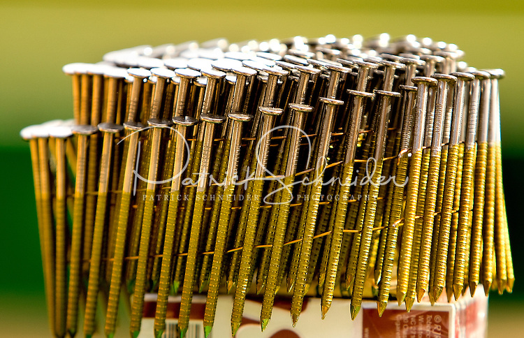 Detail photo of a grouping of nails to be used in chapel construction in Belmont, NC.