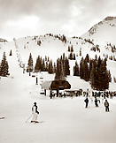 USA, Utah, skiers at the base of the Sugarloaf chair lift, Alta Ski Resort (B&W)