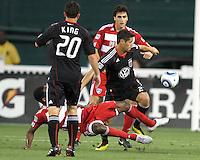 Branko Boskovic #27 of D.C. United pushes the ball past Jair Benitez #5 of FC Dallas during an MLS match at RFK Stadium in Washington D.C. on August 14 2010. Dallas won 3-1.