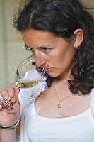 Sylvie Courcelle, daughter to Francis Courcelle, owner and winemaker, tasting a glass of her white wine  Chateau Thieuley La Sauve Majeure  Entre-deux-Mers  Bordeaux Gironde Aquitaine France