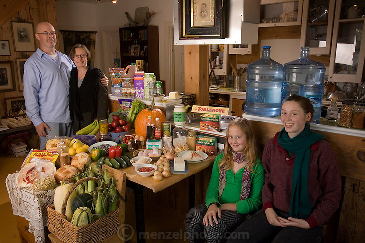 Finken family at home in their straw bale suburban home in Gatineau, Quebec, Canada. The Finken family: Kirk, 43, Danielle Roy, 50, Anna, 11, and Coco Simone (called Coco). ONE WEEK'S FOOD IN October. The Finkens of Gatineau, Canada. Food Expenditure for One Week: $141.43 US dollars.
