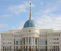 "Peter Hitchens stands in front of the ""White Building"" which is the presidential palace in the new main boulevard in the newly built capitol of Kazakhstan, called Astana which translates as ""capitol"" , 20th October 2010.<br />