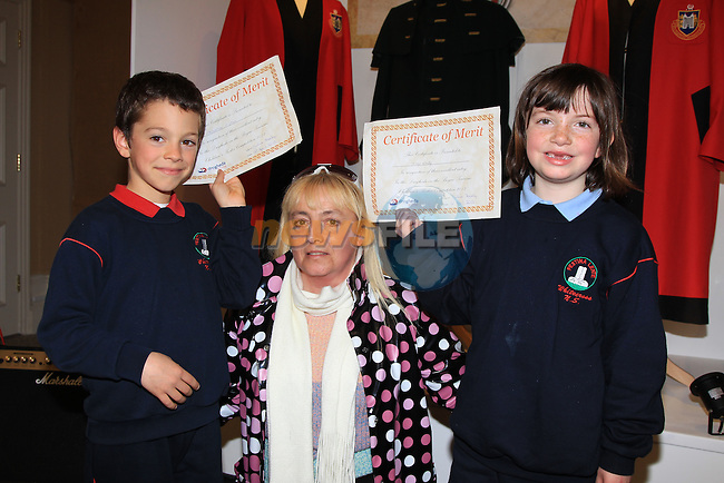 Mathew O'Shea and May reilly with Julie Feeley.dog fouling art competition..Picture: Fran Caffrey/ www.newsfile.ie.
