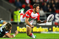 Picture by Alex Whitehead/SWpix.com - 01/05/2014 - Rugby League - First Utility Super League - St Helens v London Broncos - Langtree Park, St Helens, England - St Helens' Tommy Makinson passes the ball as he's tackled by London's Mike McMeeken.
