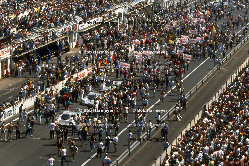 LE MANS, FRANCE - JUNE 11: The three cars of Team Sauber Mercedes are surrounded by the crowd as they finish first, second and fifth in the 24 Hours of Le Mans at the Circuit de la Sarthe in Le Mans, France, on June 11, 1989.